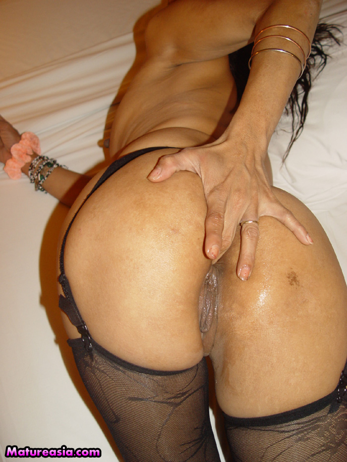 Mature asian anal
